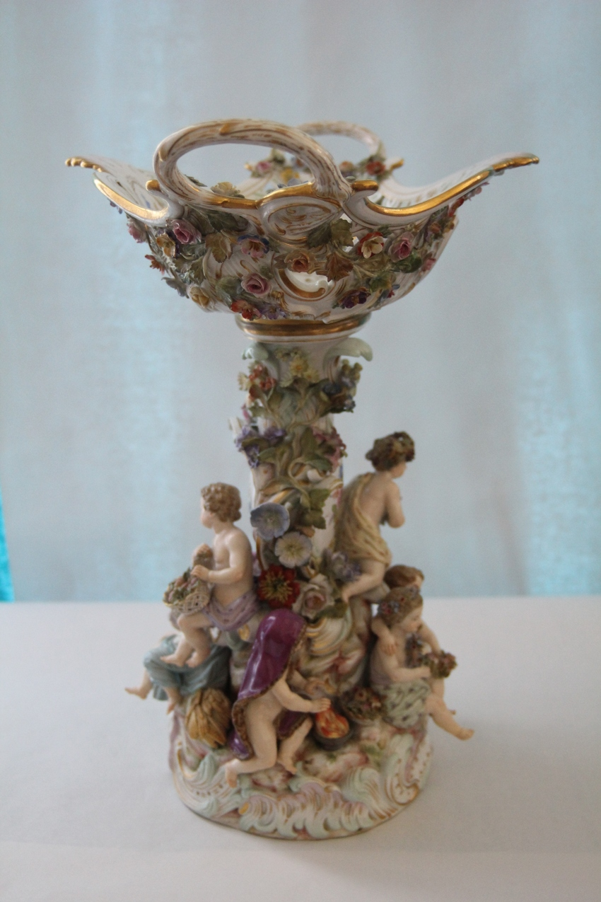 A Meissen Flower Encrasted Reticulated Centerbowl and Stand Emblematic of the four season