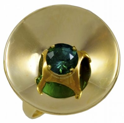 An Gold concave dish shaped Ring set with a glowing Green Gem Zircon