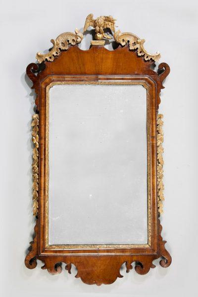 A George II walnut and parcel gilt mirror
