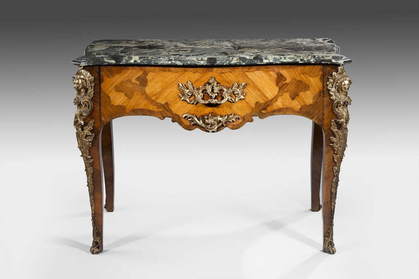 A rare 19th Century French Serpentine Table with a marble top and ormolu mounts.