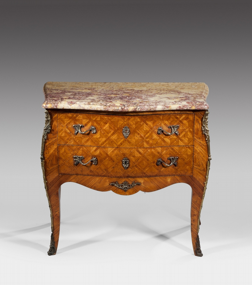A French 19th Century Kingwood Parquetry Commode.