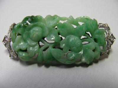 Carved jade and diamond pin